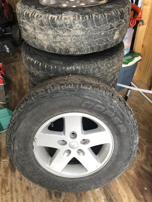 Jeep factory tires and wheels for Sale in Chestertown, MD