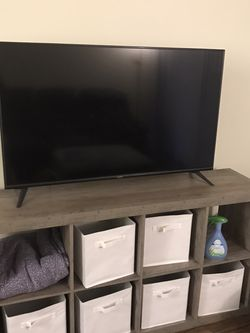 SMART TV AND TV STAND for Sale in Los Angeles,  CA