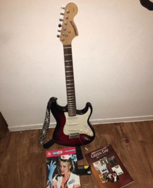 Fender guitar with tab books for Sale in Las Vegas, NV