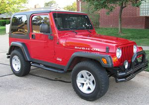 Red 2004 WRANGLER JEEP 4X4 AWDWheels Good for Sale in Jackson, MS