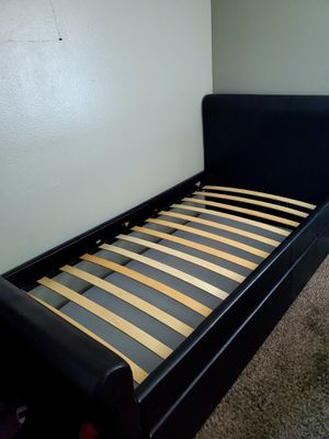 Twin bed-frame with pullout. for Sale in San Bernardino, CA