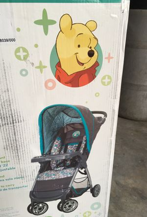 Winnie the Pooh stroller and car seat NEW for Sale in Tulare, CA