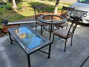 4 chair circular glass, tile and metal dinette set with matching coffee table. for Sale in Ruskin, FL
