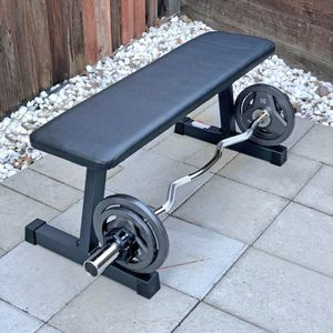 (Brand New) Flat Bench and Olympic Curl Bar with Weights for Sale in San Jose, CA