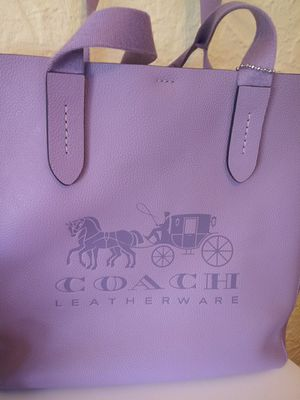 2pc lavender leather coach the wallet is supper cute wallet 65.00 the purse 115.00 both drand new for Sale in St. Louis, MO