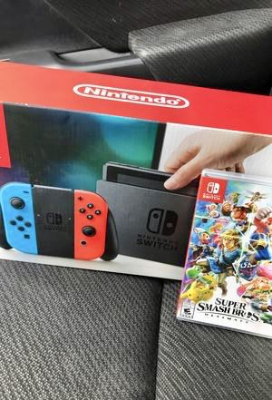 NEW NINTENDO SWITCH AND SMASH BROS ULTIMATE BUNDLE for Sale in North Lawrence, OH