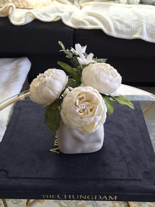 Fake flower arrangement with vase