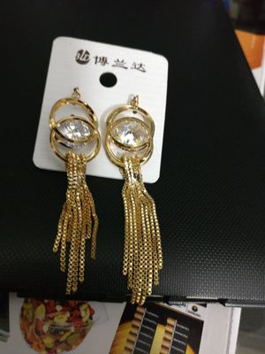 Bold and beautiful gold and single shiny diamond earrings for Sale in Seattle, WA