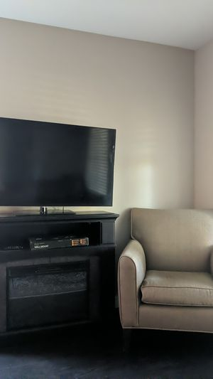 1080p Smart T.V., Wall Mount, Fireplace, & Armchair for Sale in Las Vegas, NV