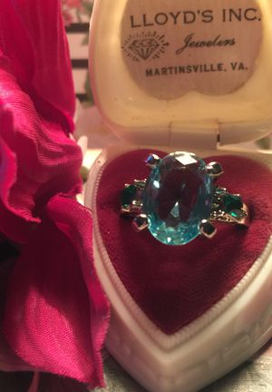 Beautiful sea blue sapphire 3.5 mm with little Emeralds on side set on plated silver quality band size 7 for Sale in Northfield, OH