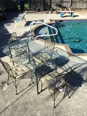 5 foot wrought iron glass table and chairs in mint condition for Sale in West Palm Beach, FL