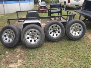 Tires and rims with chevy center caps for Sale in Eastman, GA