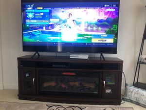 75in Samsung 4K smart tv and a electric fire place for Sale in Ashburn, VA