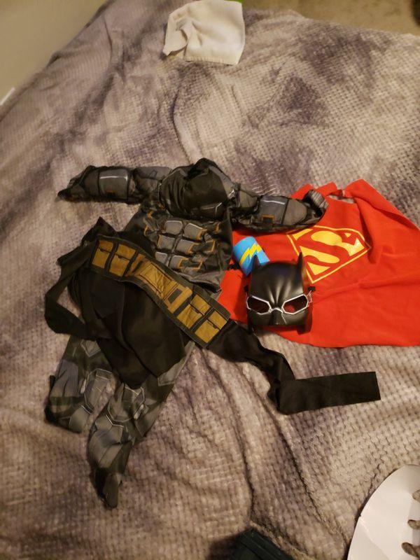 Batman suit and superman/supergirl