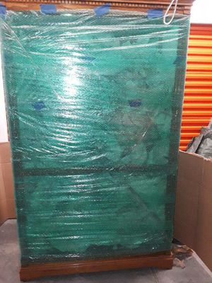 Large wood curio glass cabinet with glass shelving for Sale in Katy, TX