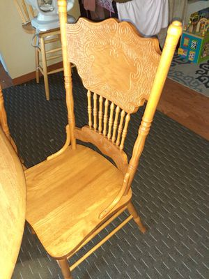 Table with four chairs, one of the chairs is missing a stick as you can see in the last photo. for Sale in Kent, WA