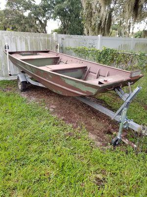 Alumacraft 14 ft Jon Boat with 15hp Outboard and Rip Tide Trolling Motor for Sale in Winter Haven, FL