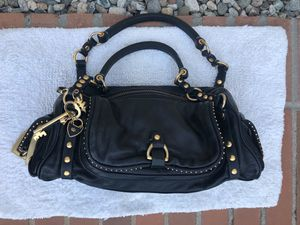 Juicy Couture Black leather handbag with gold key lock for Sale in Los Angeles, CA