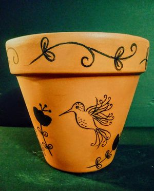 Whimsical hummingbirds and flowers painted on clay pot for Sale in Phoenix, AZ