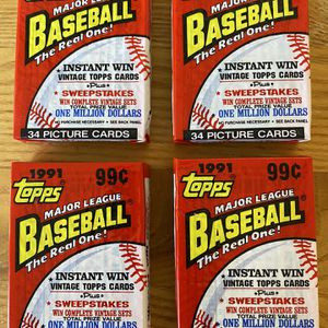 4 New Cello Packs of Topps 1991 Baseball Cards 34 Cards In Each Pack for Sale in Huntington Beach, CA