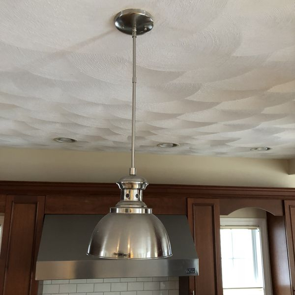 Brushed nickel pendant lights (2). Perfect for kitchen island. 9 inches in diameter and hangs approx 18 inches from ceiling.
