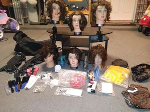 Hairdresser mannequin heads in large black duffle bag with accessories and tools. for Sale in Frisco, TX