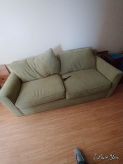 Olive green couch for Sale in Longmont,  CO