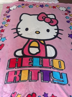 HELLO KITTY LARGE PLUSH BLANKET FITS TWIN BED. AND PILLOW CASE I HAVE MANY MORE CLOTHES AND ITEMS AVAIABLE for Sale in Riverside, CA