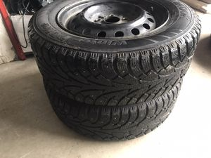 205/65/R15 94T studded tires with rims for Sale in Gresham, OR