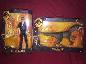 Jurassic Park Amber Collection Dr. Ian Malcolm & Velociraptor Action Figures for Sale in Queens, NY