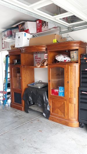 Solid oak come with two leaf can be small or big both sides has shelf for DVD for Sale in Winchester, CA