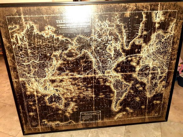 42x52 a map of telegraph lines that connect the world together it is canvas on wood base with black plastic frame retail for 169.99