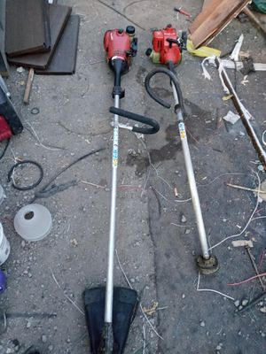 Straight and bent shaft gas string trimmers Homelite and Echo for Sale in Cleveland, OH