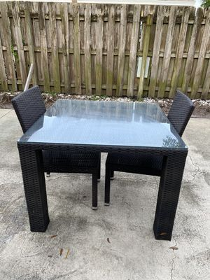 Outdoor table with two chairs from City Furniture. (Glass top) for Sale in LAKE CLARKE, FL