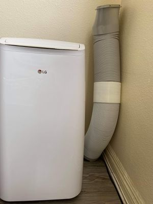 LIKE NEW LG Portable AC w/ Dehumidifier Function and LCD Remote in White. Free Long Hose for Sale in Los Angeles, CA