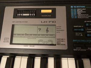 Casio Keyboard with stand - LK170 (with lighted keys) for Sale in Cumming, GA