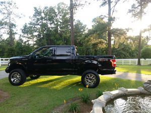"Up for sale is this 2018 f150 xlt, with ONLY 3,500 miles!! Brand new 5"" rough country suspension lift, New 35x12x50x20"" mud tires, and 20"" chrome gea for Sale in Broxton, GA"