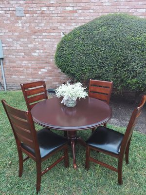 wooden table with 4 chairs high 30 round table 42 good condition for Sale in Houston, TX