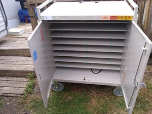 Big cabinet with removable shelves Caster wheels on bottom for Sale in Apollo Beach, FL