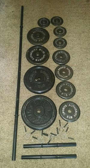 Weights metal 100lbs. 2x25lb, 2x10lbs, 4x5lbs, 4x2.5lb, 5 foot straight bar and 2 dumbbell bars. 6 weight lock clips. for Sale in Deerfield Beach, FL