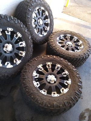 """18"""" off road rims with nitto trail grappler tires for Sale in Las Vegas, NV"""