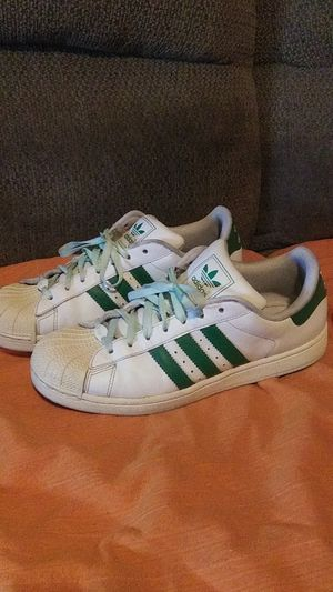 Green n white Adidas shoes for Sale in Hedgesville, WV
