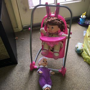 Baby girl dolls with swing/high chair for Sale in Los Angeles, CA