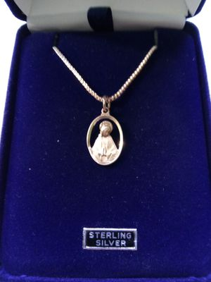 Sterling Silver Praying Madonna Medal on an 18 inch stainless steel chain. Religious jewelry. for Sale in Stockton, CA