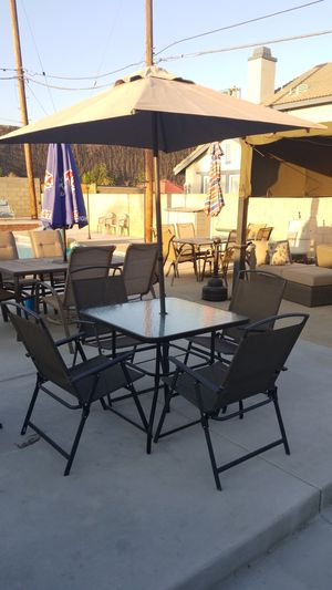 Patio set, glass patio table 4 foldable chairs and umbrella for Sale in Ontario, CA