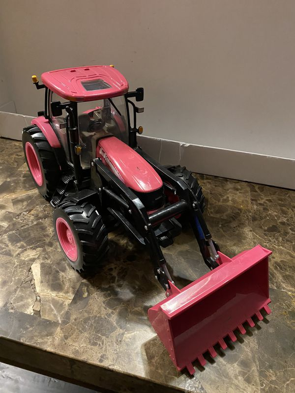 "Pink Big Farm Case IH Tractor With Loader Lights & Sounds ERTL. Measures 17"" long 8"" height."
