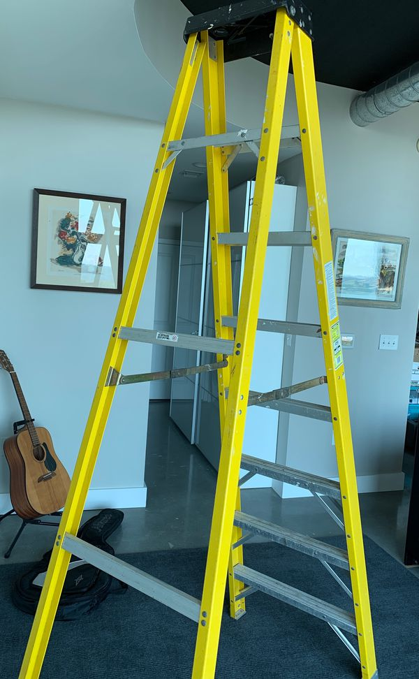 8 foot fiberglass Electro-Master ladder rated to 300 pounds