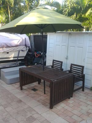 Outdoor furniture wood table 4 chairs and Large Umbrella with crank for Sale in Pompano Beach, FL