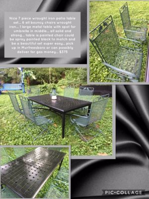 Nice 7 piece wrought iron patio table set... 6 all bouncy chairs wrought iron... 1 large metal table with spot for umbrella in middle... all solid and for Sale in Murfreesboro, TN
