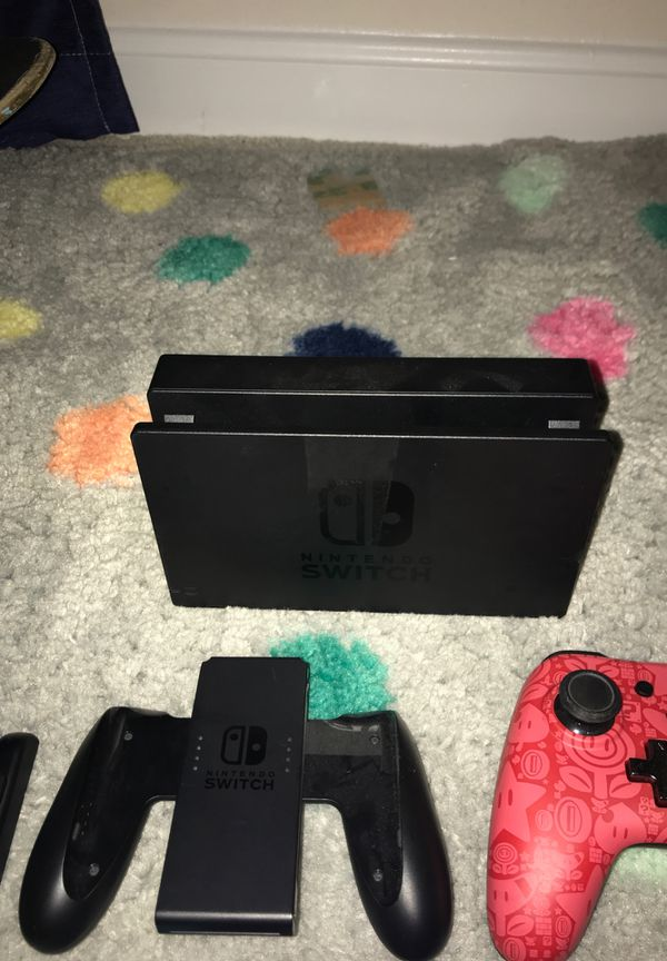 Nintendo Switch With Charger, JoyStick Holder, Nintendo Controller, Tv Screen Dock, Nintendo Switch Protective Case. Supper Smash Bro's Ultimate, Arm
